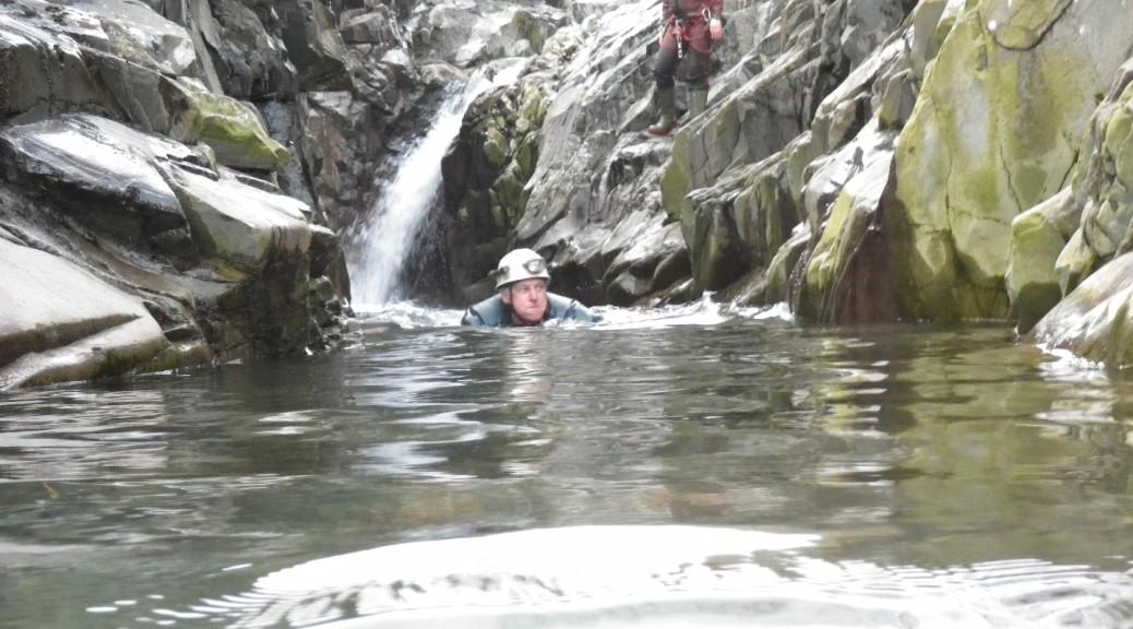 Ken holding his breath as he swims through a dead sheep - Coniston 2012