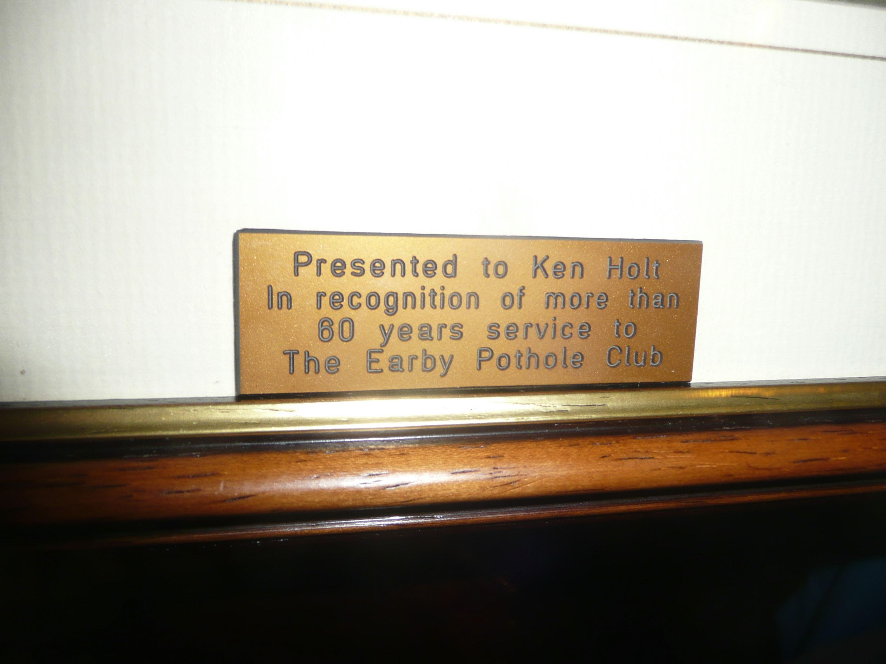 The inscription on Ken Holts long service award 2010