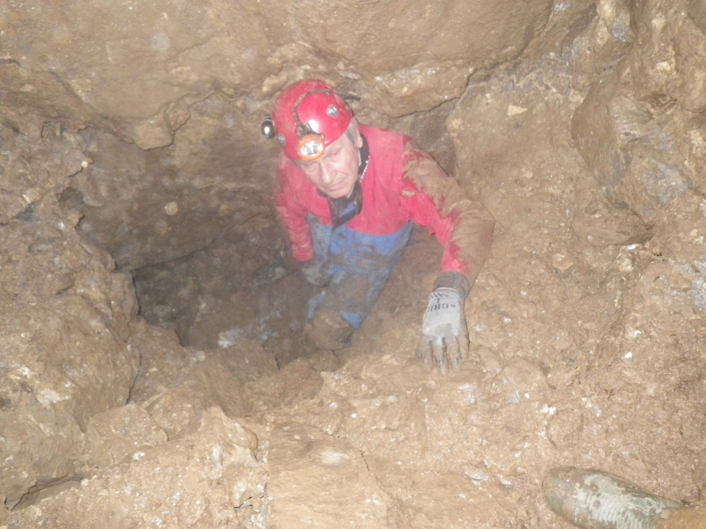 Keith digging at the bottom of the cave